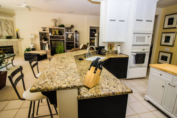 Granite counter top with bar stools in kitchen picture id1168385923?b=1&k=6&m=1168385923&s=612x612&w=0&h=owcekgcatywixwvg4xlrw3sheinqlkd9fvpmjzucpyq=