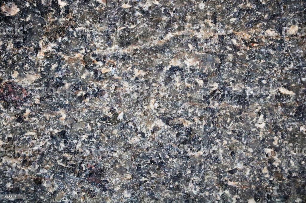 Granite in gray tones. Texture. Building material. stock photo