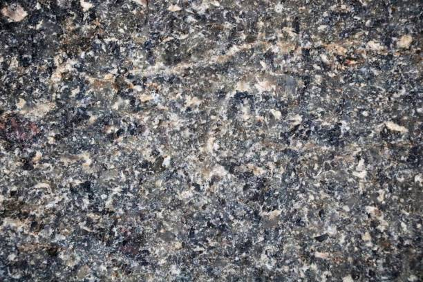 granite in gray tones. texture. building material. - granite rock stock photos and pictures