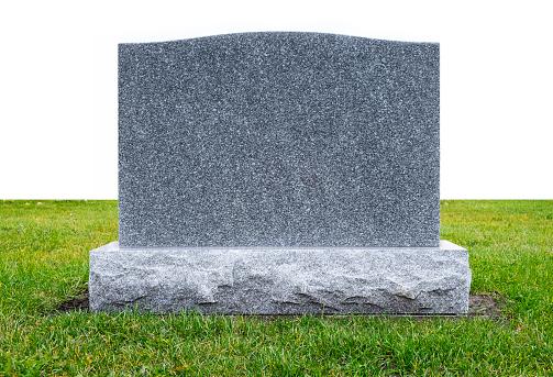 Granite Monument Stone on Green Grass