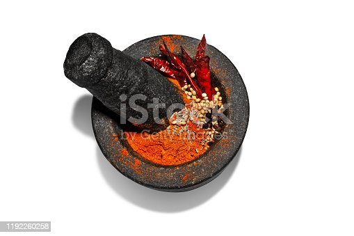 Granite mortar and pestle with spices  for grinding