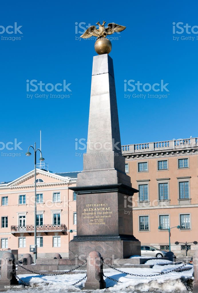 Granite obelisk with two headed golden eagle of the Empress Alexandra on Market Square in Helsinki, Finland stock photo