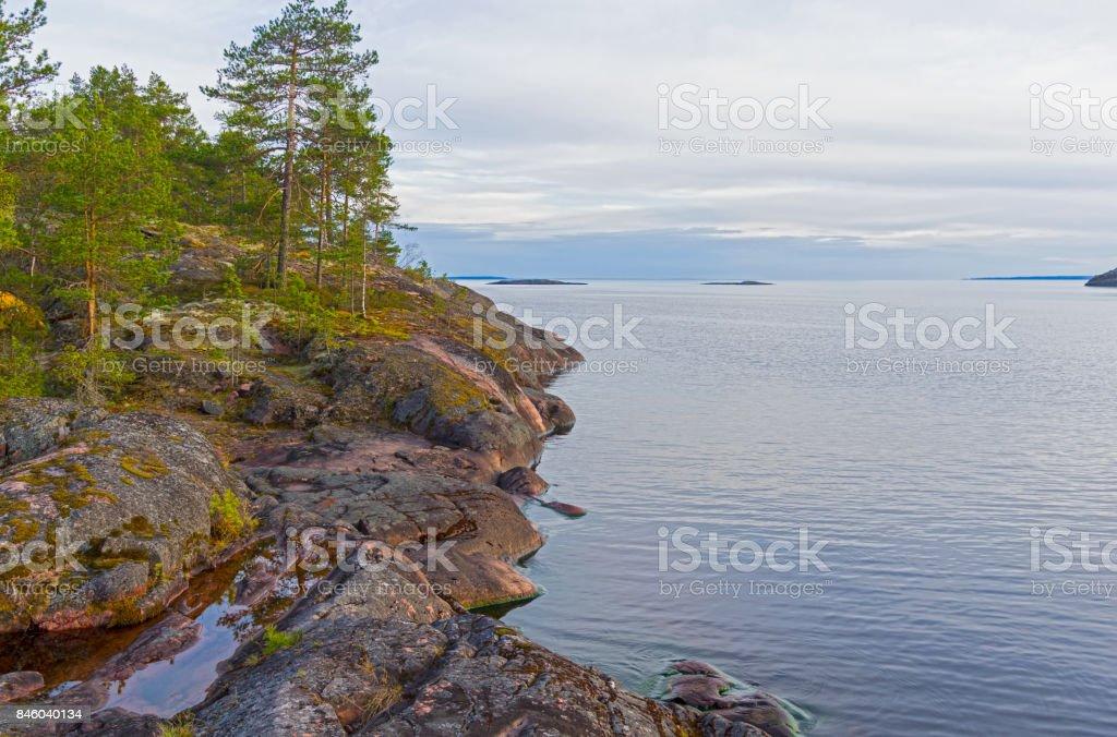 Granite rocks on the shore of Lake Ladoga. stock photo