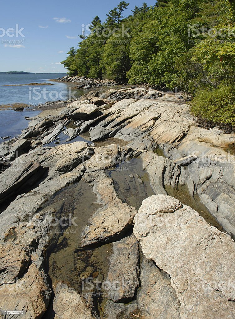 Granite shoreline at Wolfe Neck State Park in Freeport stock photo