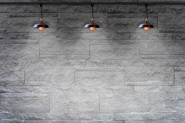 Granite stone dekorativen Wand mit Lampe – Foto