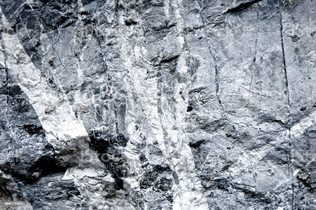 Granite stone texture grunge scratched wall background rough. Abstract construction concrete stone wall. Mountain rock or volcano stone. Cool and chic adventure wallpaper. Black and white color. Close up. stock photo