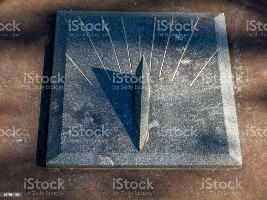 Granite Sundial - sun clock on granite table stock photo
