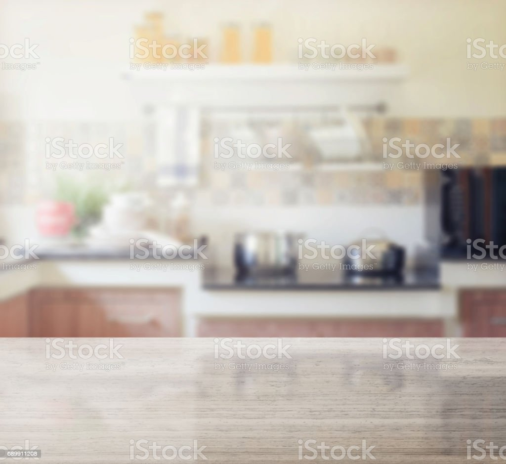 granite table top and blur of modern kitchen interior as background stock photo