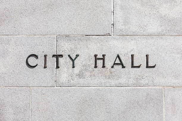 Granite Wall CIty Hall Sign City Hall sign on a stone cold granite wall. town hall stock pictures, royalty-free photos & images