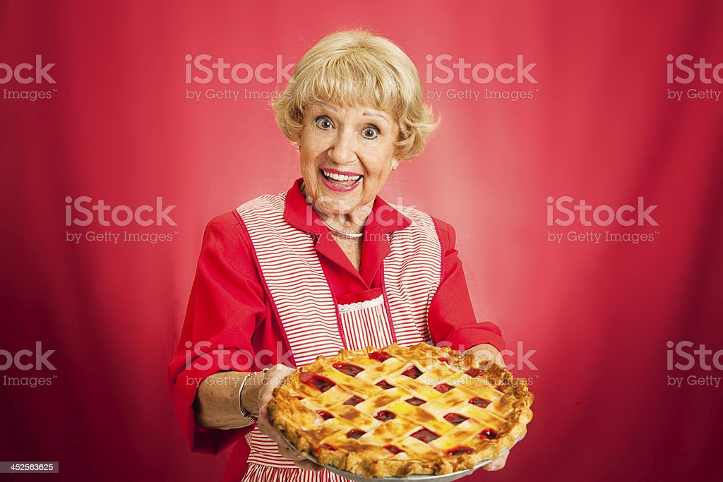Granny Holding Lattice Top Cherry Pie stock photo