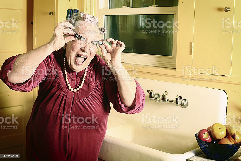 Granny in Kitchen with Cat's Eyes Glasses stock photo
