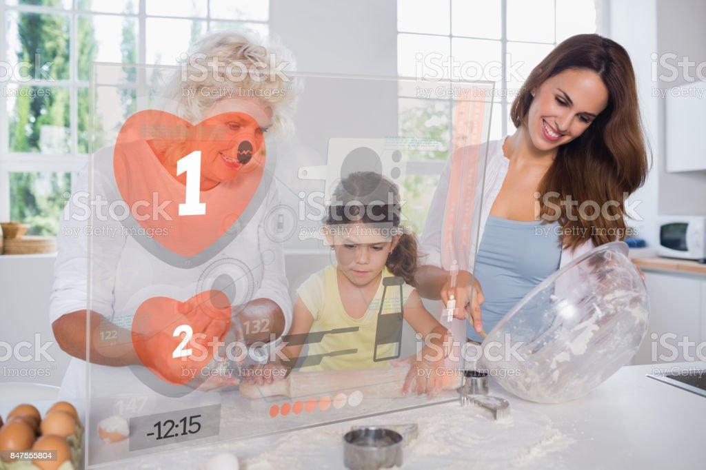 Oma Mutter und Kind machen Cookies mit futuristischen Schnittstelle – Foto