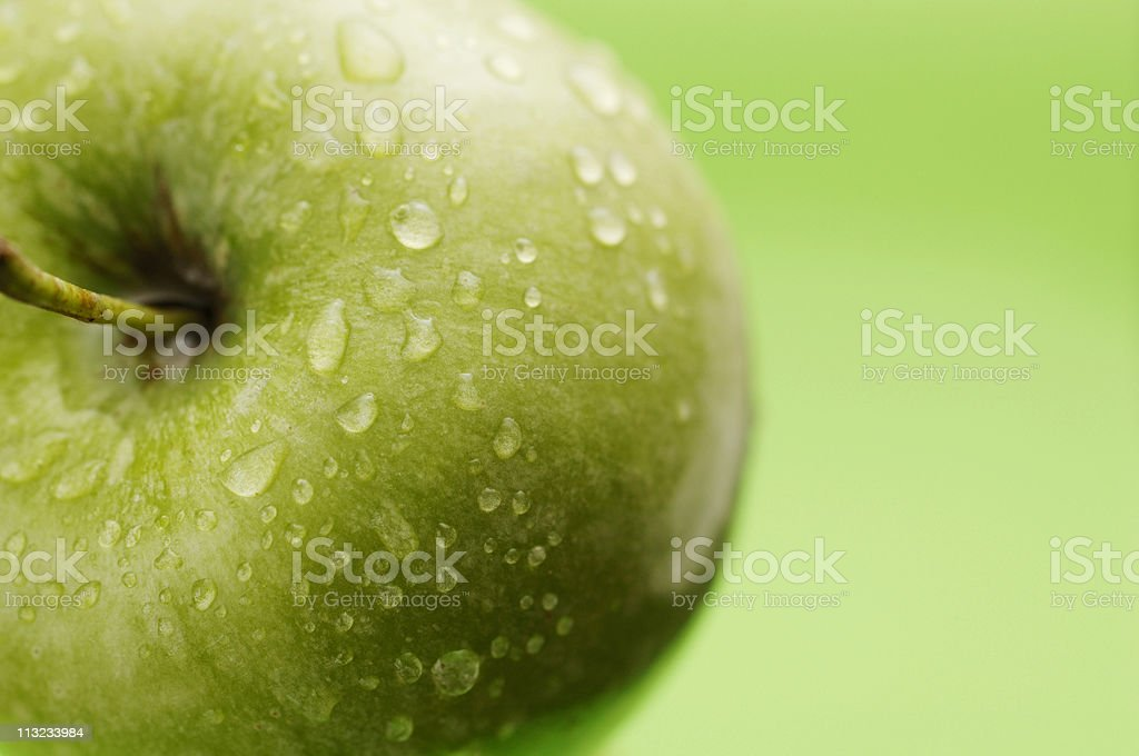 granny smith apple against green royalty-free stock photo
