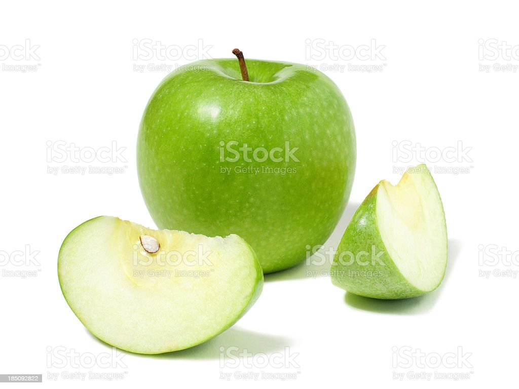 Granny Smith Apple and two apple wedges on white background stock photo