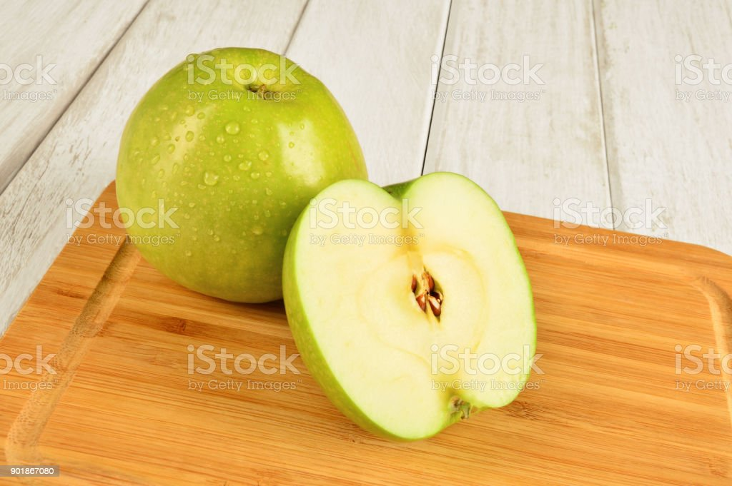 Granny Smith Apples on Cutting Board stock photo