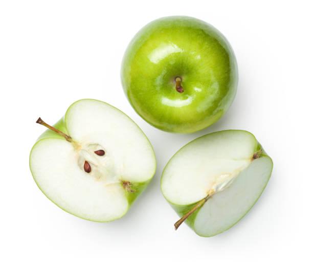 granny smith äpfel auf weiß - 25 cent stück stock-fotos und bilder