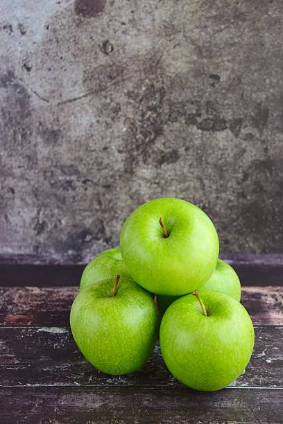 Granny Smith Apples Granny Smith Apples granny smith apple stock pictures, royalty-free photos & images