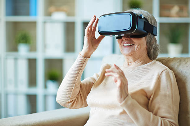 Granny with modern technology stock photo