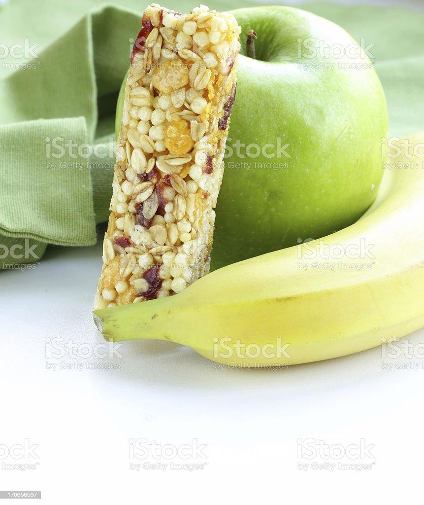 granola bar, green apple and banana - healthy eating royalty-free stock photo