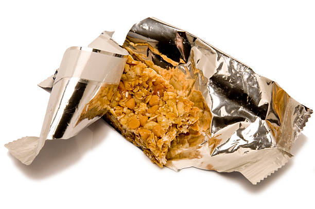 Granola Bar In Opened Wrapper Stock Photo