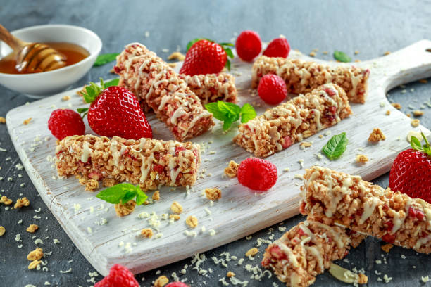 Granola bar with strawberries raspberry honey and white chocolate on picture id680214750?b=1&k=6&m=680214750&s=612x612&w=0&h=ql14pcbdi can0m5esaip0kk peypyiplnxoiw1tfta=
