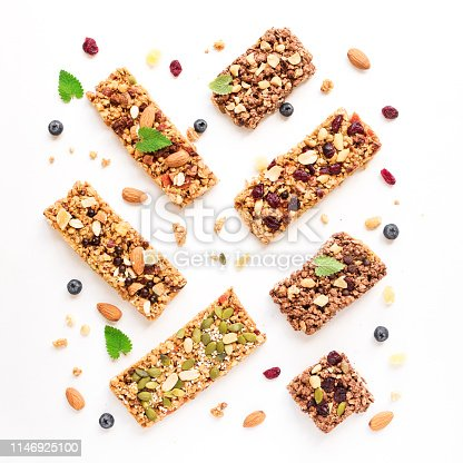 Various granola bars isolated on white background, top view. Homemade healthy snack - granola superfood bars.