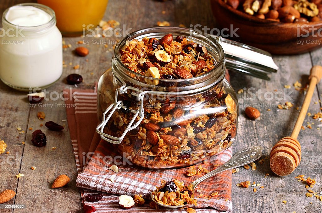 Granola in a glass jar. stock photo