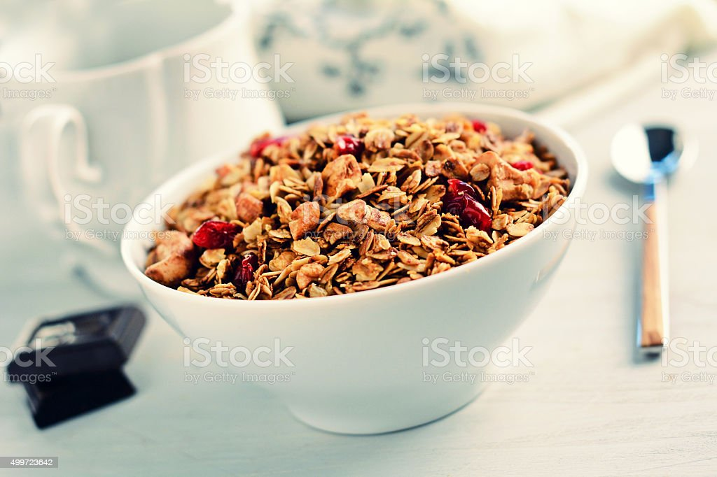 Granola or muesli in bowl. Healthy retro breakfast stock photo