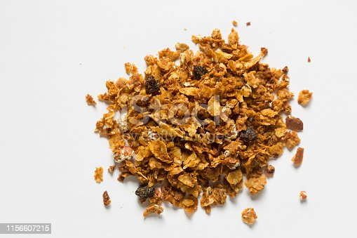 Homemade granola made with oats, bran flakes, coconut, honey, raisins and peanuts covered with sesame seeds.