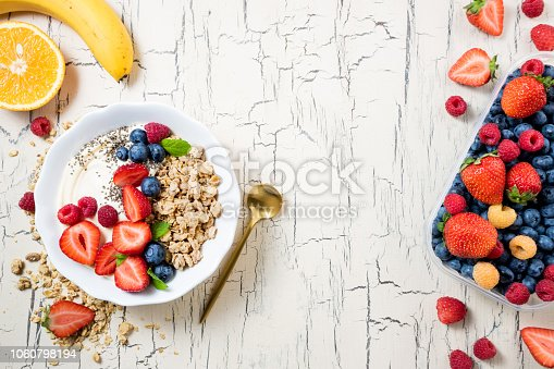825171518 istock photo Granola with berries, yoghurt and fruits for breakfast. Cereal oatmeal with strawberries, blueberries and raspberries. Muesli with fruits and berries. Diet, healthy food 1060798194