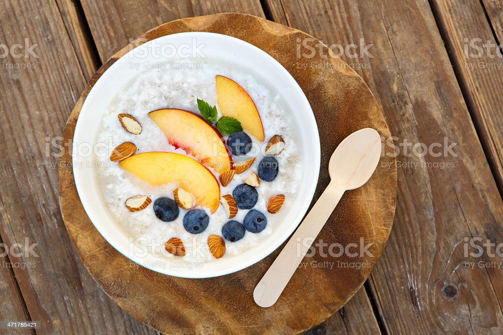 Granola with fresh organic blueberries, nectarines and almonds royalty-free stock photo
