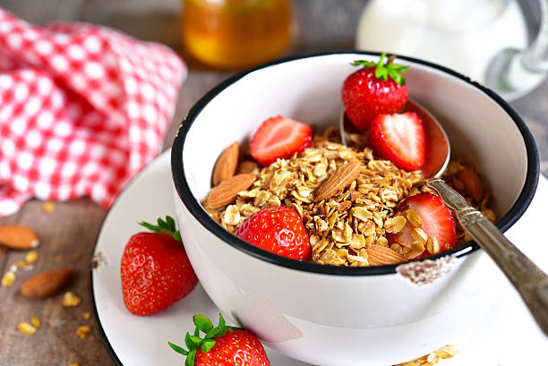 Granola with fresh strawberry - healthy breakfast. stock photo