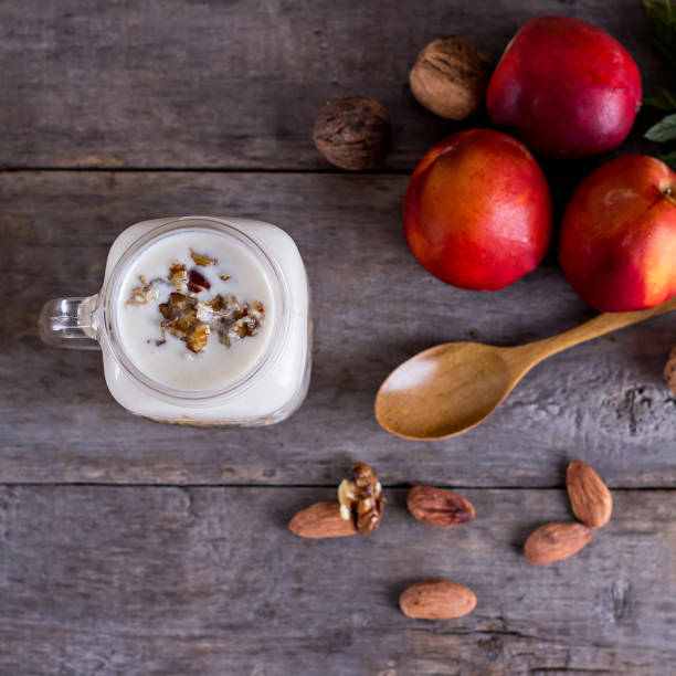 Granola with natural yoghurt, peaches and nuts stock photo