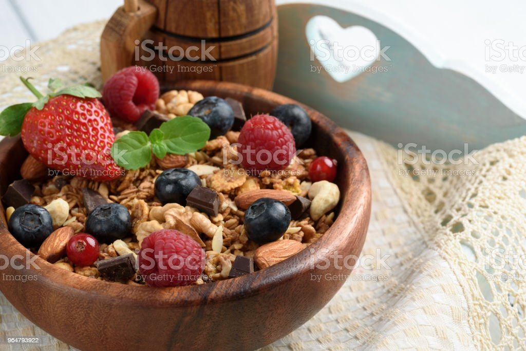 Granola with natural yogurt, fresh blueberries, nuts and honey, delicious breakfast or dessert.Healthy eating concept. royalty-free stock photo