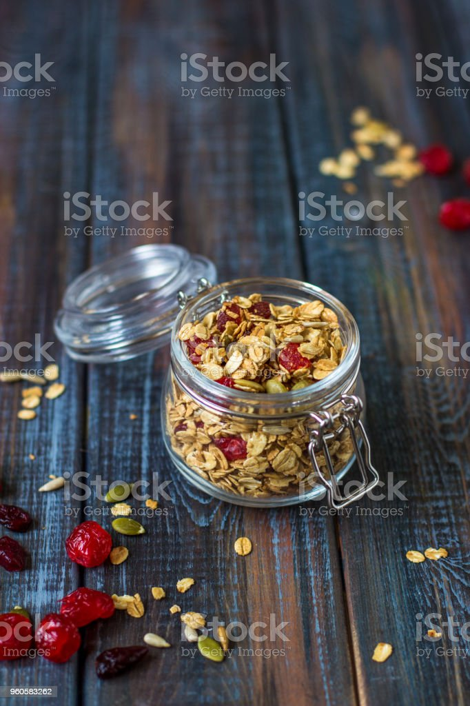 Granola with yoghurt, dried berries and pumpkin seeds stock photo
