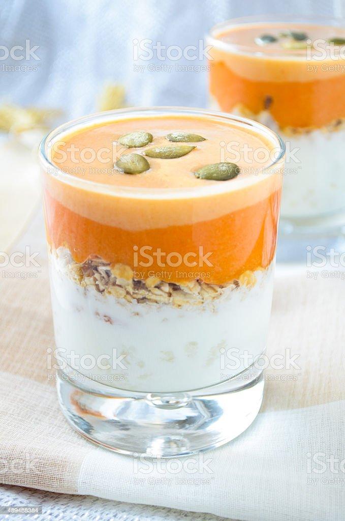 granola with yogurt, pumpkin hard sauce and seed stock photo