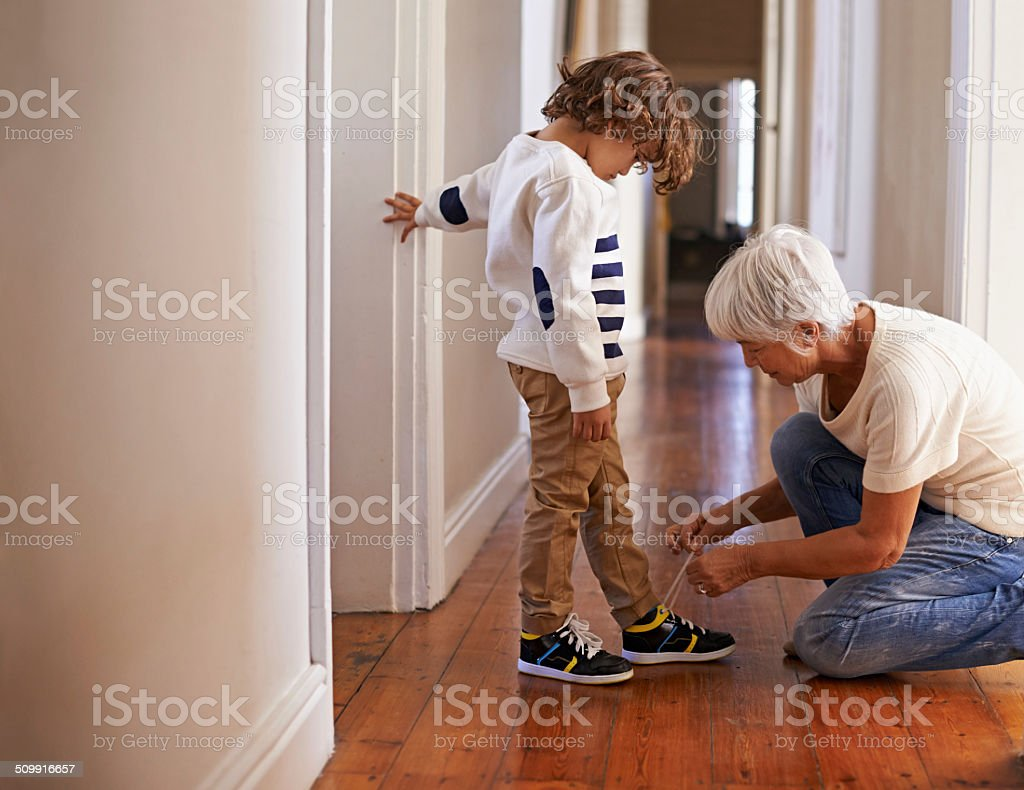 Gran's helping him out on this one stock photo