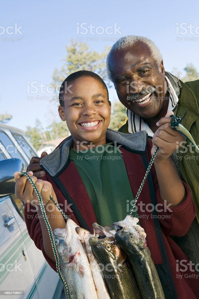 Granson and Grandfather with Stringer of Fish stock photo