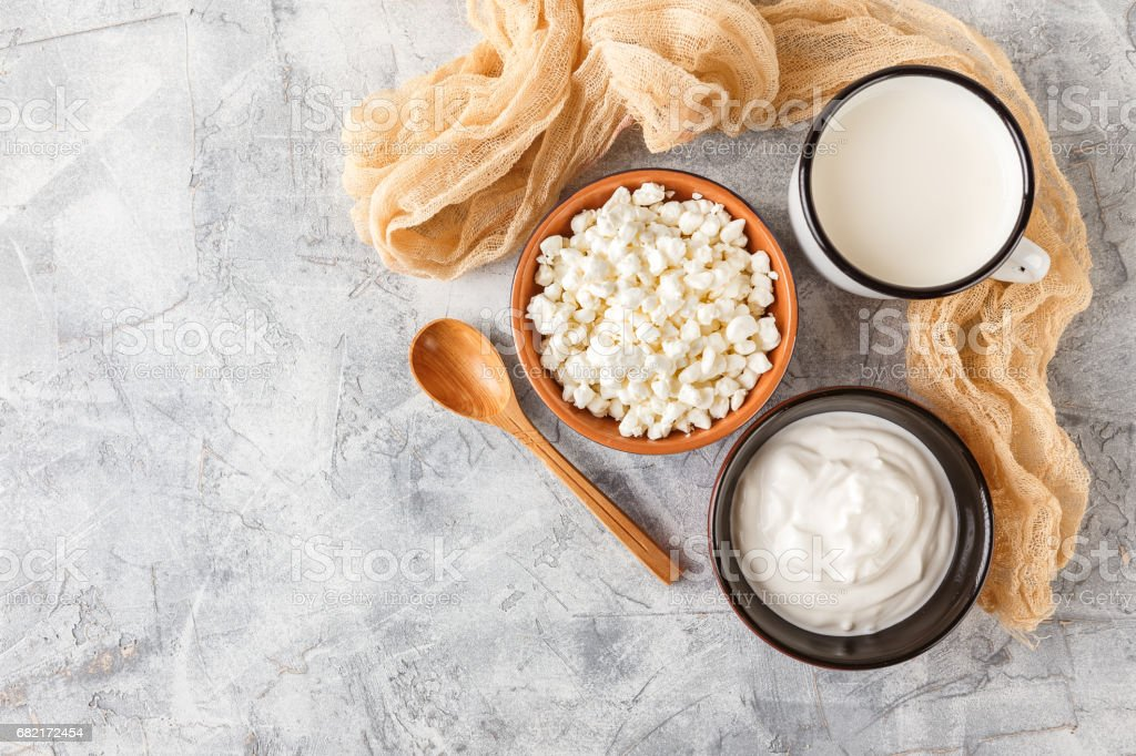 Granulated cottage cheese and sour cream stock photo