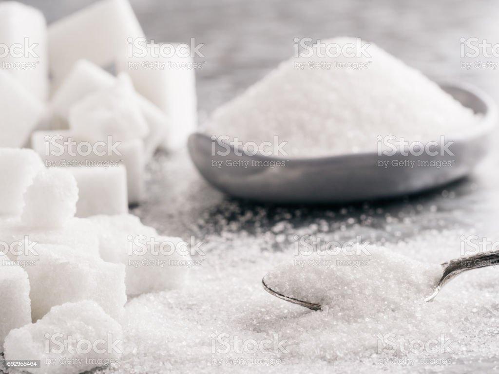 Granulated sugar and cubes of sugar stock photo