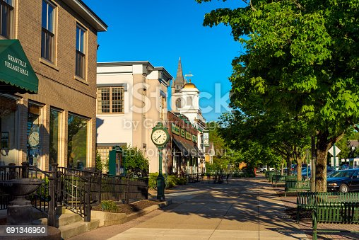 GRANVILLE, OH - MAY 15, 2017: Churches and businesses line a shady block of Broadway Avenue in this small collgee village in east central Ohio.