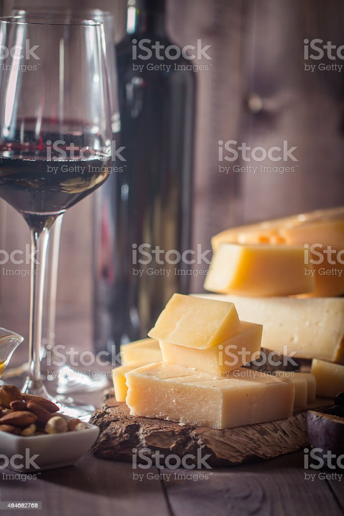 Grape and cheese variety with a red wine stock photo