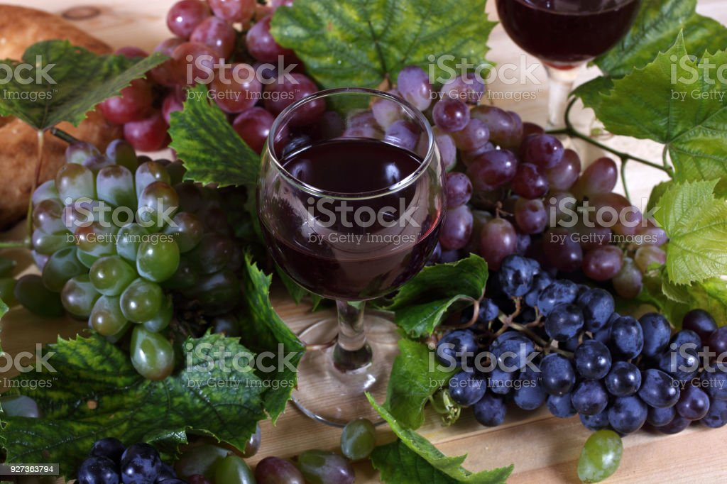 Grape and wine on table Autumn harvest. Young grape Agriculture Stock Photo
