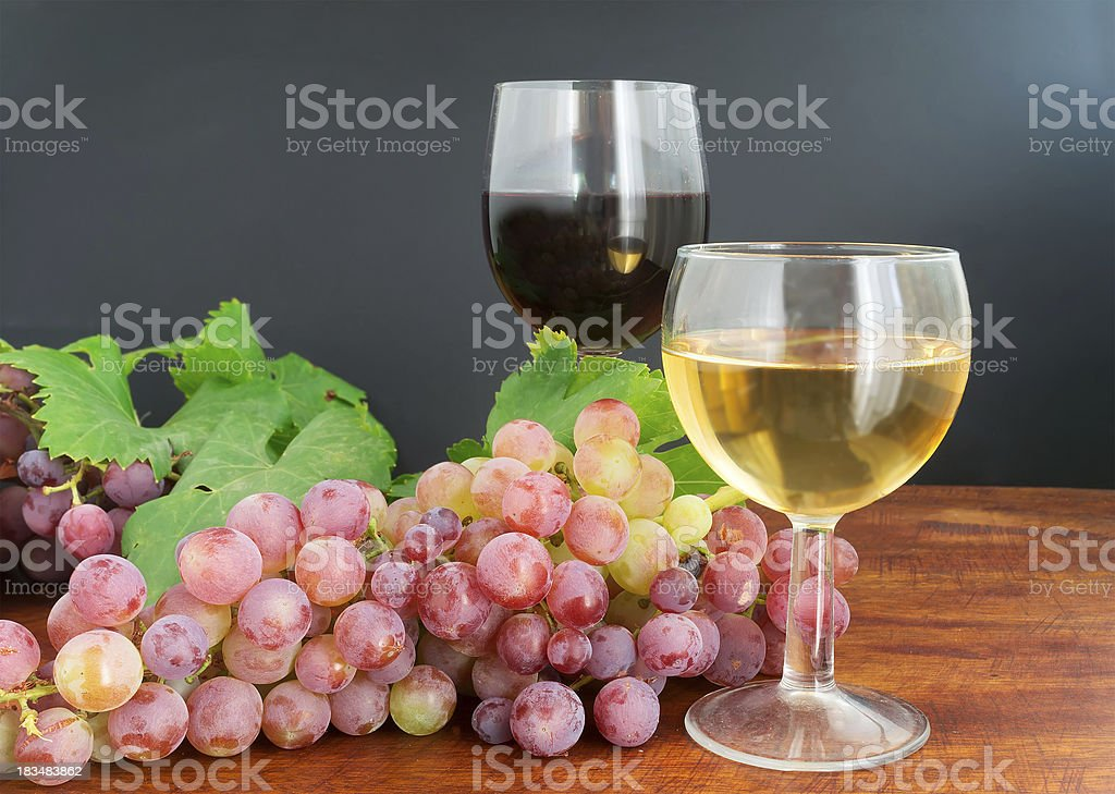 grape and wine on wood royalty-free stock photo