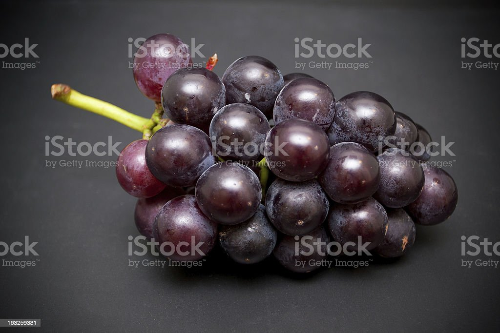 Grape cluster isolated on black background royalty-free stock photo