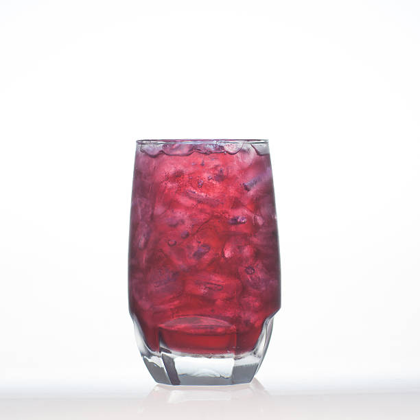 Grape flavor aerated drinks whit soda in glass isolated stock photo