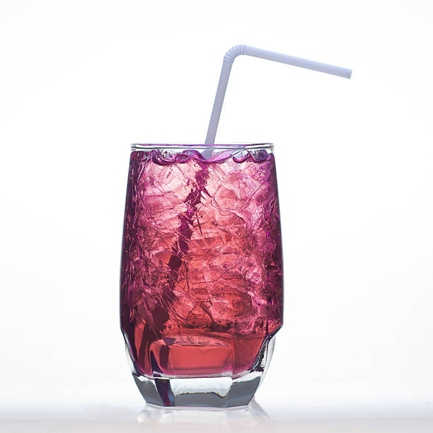 Grape flavor soft drinks whit soda water isolated stock photo