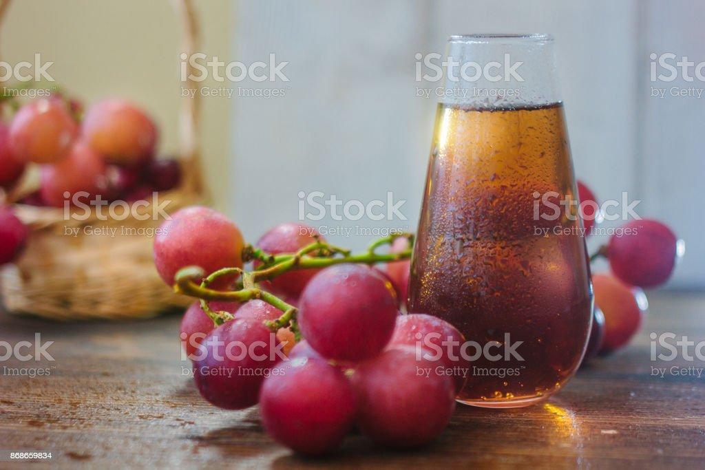 Grape juice in glass stock photo