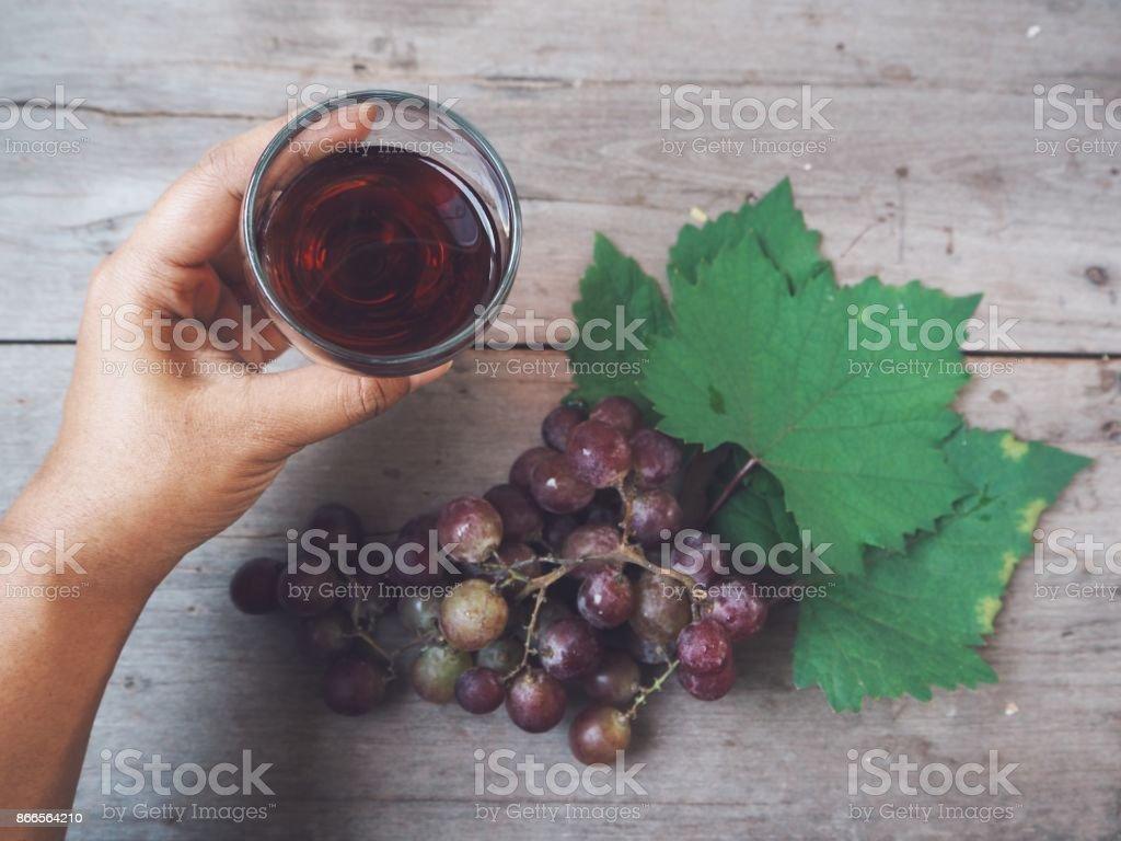 Grape juice on hand stock photo