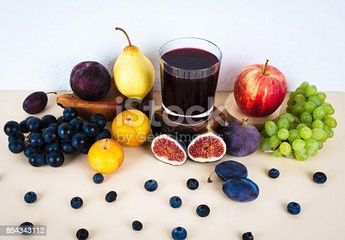 istock Grape juice with autumn seasonal fruits. 854343112